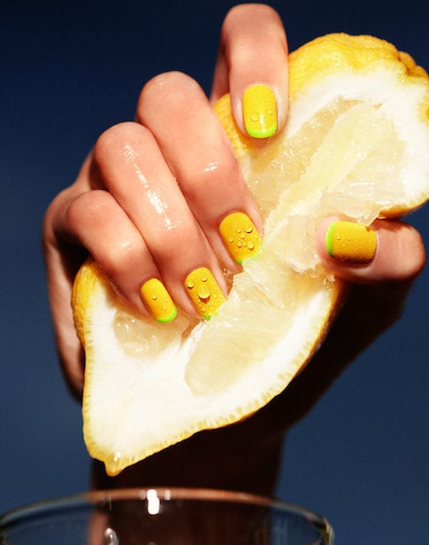 hand and lemon